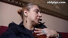 Mature classy woman banged by a young cock in a sofa