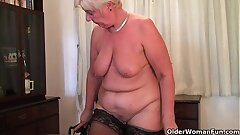Brit and total figured granny Sandie masturbates with a dildo
