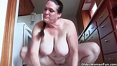 Grandma with big boobs cleaning the kitchen bare