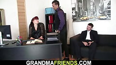 Two dudes share shaved office pussy, old gal