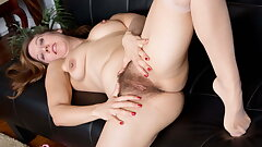 Hairy milf Valentine plays with her cave woman style vagina